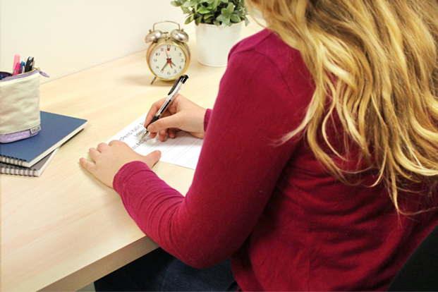 Sit comfortably straight so that your forearms lay gently on the desk.