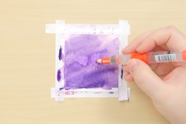 Scrub unwanted pigment out of the paper with a wet brush.