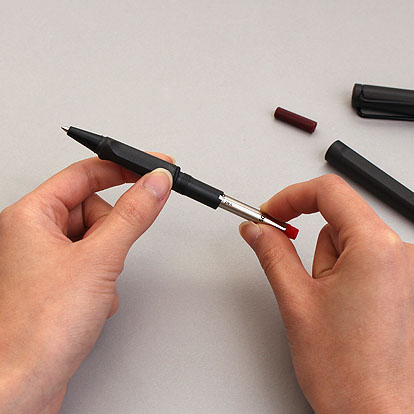 Place the refill inside the grip of the pen.